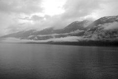 Alaskan Mountains (Poopshe_Bear) Tags: ocean cruise summer vacation sky cloud mist mountain mountains water fog alaska clouds landscape blackwhite horizon peaceful serenity americana artic alaskan