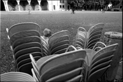* (rumorebianco) Tags: people bw sitting chairs head streetphotography delta full 35mmfilm mantova frame 100 nikkor nocrop ilford nikonf4 2428