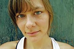 Annelies 89 (yospyn) Tags: woman green face ambientlight nikond2x outdoorportrait whitetanktop naturallightdoneright