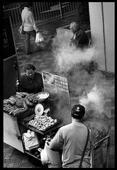 Smoke- Mongkok, Hong Kong (Paul Swee) Tags: blackandwhite food film hongkong streetphotography xp2 chestnut  summicronm50 leicasummicronm50mmf2 paulswee leicasummicron50mmf20v leicammount  2008novroll3