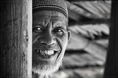 Iman (NeilsPhotography) Tags: portrait people bw smile indonesia 2008 sulawesi iman rtwoverland