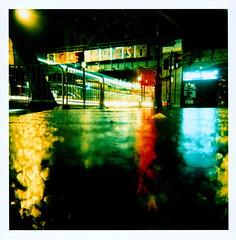 Brixton (Matt Brown esq) Tags: bridge colour reflection london water sign contrast holga lomo xpro lomography crossprocessed stream fuji crossing traffic angle pavement ground slide junction sidewalk fujichrome provia brixton mattbrownesqportfolio