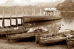 Keswick 26-07-08 111 sepia (Big Warby) Tags: uk greatbritain summer england lake david mountains monochrome beautiful sunshine sepia reflections walking landscape boats town unitedkingdom ships lakedistrict lakeside hills landing views gb rowing derwentwater ropes launch keswick davidwarburton waterposts warburton2 bigwarby