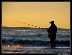 Winter Surfcaster (Ryan Schain) Tags: ocean morning blue sunset red sea orange sun beach water yellow sunrise dawn fishing surf dusk line atlantic rod hook atlanticocean bait surffishing reel sinker surfcasting