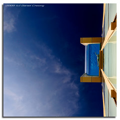 Swimming on the Edge (DanielKHC) Tags: city blue abstract glass pool festival swimming hotel interestingness high nikon dubai dynamic uae explore swimmer minimalism range dri hdr intercontinental d300 dynamicrangeincrease coolshot outstandingshots danielcheong infinestyle bratanesque danielkhc great123 gettyimagesmeandafrica1