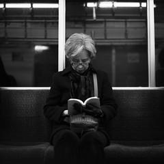 ... (motionid) Tags: bw woman 6x6 japan rolleiflex train mediumformat subway reading tokyo book d76 squareformat tmax400 800 autaut motionid rolleiflexgx28 womanreadingbook