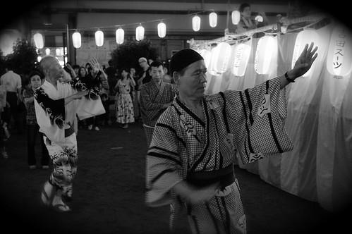 Japanese Men Dancing At An Obon Festival