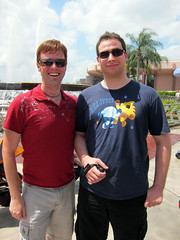 ian with a dude at epcot wearing his eclipse t-shirt