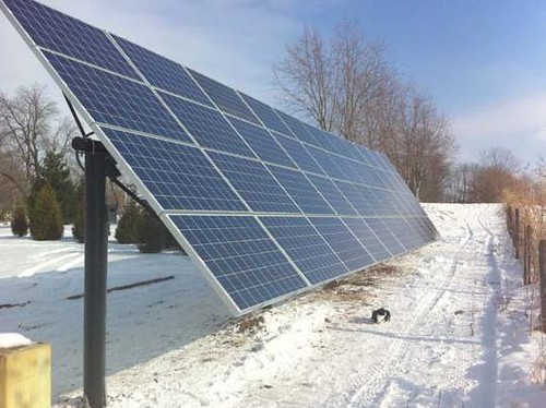 This solar module, funded in part through USDA's Rural Energy for America Program,  is oriented to the south on a ground-mounted rack near a rural  business in Tippecanoe County, Indiana.