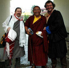 Tres Amigos, Three friends at Lam Dre, Tharlam Monastery, Tashi, Khenpo Ga Ga, and Glenn (Wonderlane) Tags: travel nepal men cane hands arms affection maroon buddhist smiles style monk buddhism clothes tibetan adi tradition enlightenment showing abbot khenpo sakya chuba tibetanbuddhist 5568 chubas khatags lamdre tharlammonastery pathandfruit laypeople blessingcord threefriendsatlamdre kalyanamitravirtuousfriends