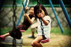 playing on the swings (moaan) Tags: park leica digital 50mm kid dof bokeh candid f10 swing m8 littlegirl noctilux dailylife 2008 ordinarylife explored leicam8 leicanoctilux50mmf10 bokehwhores gettyimagesjapanq1 gettyimagesjapanq2