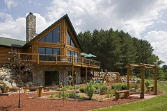 Custom Designed Log Home (Golden Eagle Log Homes) Tags: summer usa house horizontal clouds golden spring log model cabin exterior eagle timber country cottage frame stfrancis residential mn luxury landscaped loghome milled