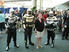 1980s Cylon costumes: the new Storm Trooper (colorblindPICASO) Tags: california ca travel costumes people public smile sarah silver gold shine boots cosplay crowd longhair chrome barefoot barefeet traveling southerncalifornia pigtails comiccon anklet blaster centurion blackhoodie battlestargalactica bsg descalzo stiefel bluecarpet blondhair barfuss sandiegocomiccon laarzen witha cylons whiteshorts sinzapatos khakishorts barfus comiccon2008 blasterrifle badbuys sdcc2008 womanposingwithpeopleincostume 7sd8hh