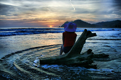 Where is Friday when I need him? (! .  Angela Lobefaro . !) Tags: trip travel pink blue sunset red sea sky seascape beach me girl beautiful hat rock stone angel clouds strand self landscape thailand atardecer sand bravo waiting rocks asia paradise tramonto nuvole sonnenuntergang stones quali