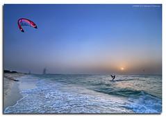 Kite Surfing By The Burj (DanielKHC) Tags: sea kite beach digital interestingness high nikon