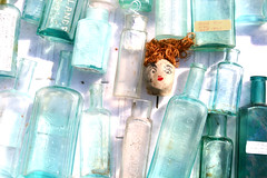 259 - Ginger Bobble Amongst Toilet Bottles (Universal Stopping Point) Tags: blue ginger doll bright head antique kentucky nail redhead oxford 365 redhair decapitated unaltered otherwise medicinebottle project365 slightlybrightened alsotheorangetagwasdesaturated