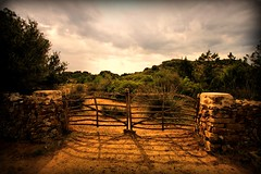 Es Grau. (Wizard Snaps) Tags: sea sun sexy beautiful sunshine digital canon island eos nice spain gate mediterranean farm photograph gateway lovely dust menorca lense sigma1020 esgrau 400d menorcangate