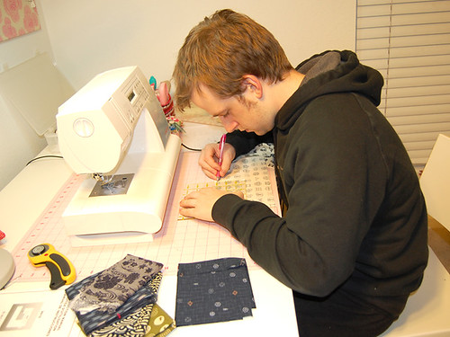 Joe measuring fabric
