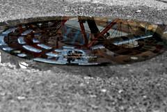 bicycle reflection (simis) Tags: red reflection building aqua bokeh spokes gray tire photowalk brake selectivecolor fromarchives utautsin