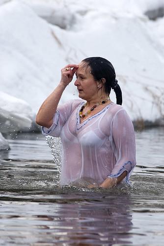 Считается, что надо три раза окунуться с воду с головой. By the tradition believers should dive three times crossing them selfs.