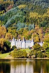 Tigh Mor, Loch Achray (Stuart Stevenson) Tags: autumn reflection castle water gold scotland canon300d trossachs tigh mor polariser lochachray tighmor stuartstevenson canoneos28135mmf3556isusm stuartstevenson