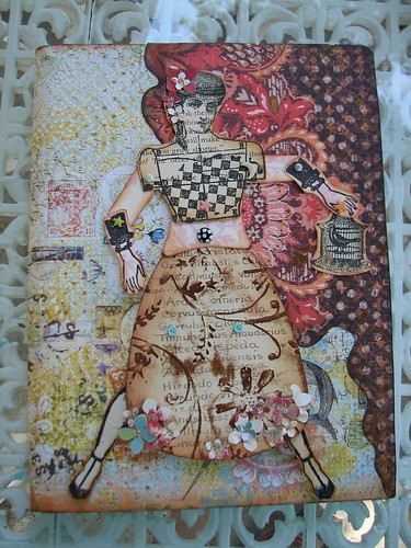paper doll on journal
