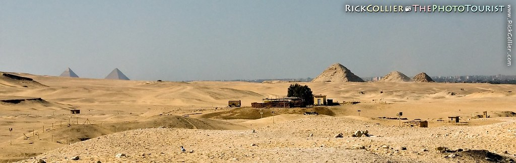 Tens of pyramids dot the plains of Saqqara, leading all the way to the Great pyramids at Giza in the distance.