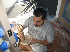 James paints the door trim. (10/31/2009)