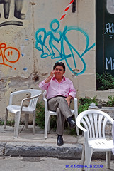 coffee break (marsthird12) Tags: street pink portrait man color coffee colors portraits relax greek chair nikon europe paint sitting break grafitti chairs relaxing greece plaka portraiture sit graffitti sidwalk monobloc d80 nikond80