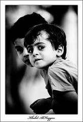 Shy smile (Khalid AlHaqqan) Tags: portrait blackandwhite bw boys smile kids canon zoom kuwait khalid 100400mm 40d kuwson alhaqqan