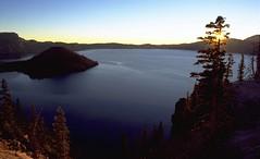 Crater Lake Sunrise Sequence #4 (wanderingYew2) Tags: blue film oregon forest sunrise landscape island volcano nationalpark crater caldera pacificnorthwest pacificcresttrail wizardisland filmscan hikingtrail cascaderange craterlakenationalpark volcaniclake mountmazama allamericanroad nationalscenictrail americashikingtriplecrown