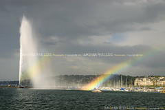 The Jet d'Eau fountain, Geneva - Switzerland (Humayunn Niaz Ahmed Peerzaada) Tags: bridge blue sea sky cloud india english water fountain clouds garden french boats switzerland boat rainbow model europe republic photographer geneva geneve jetty indian zurich jet actor maharashtra rainbows mumbai deau montblanc englishgarden lakegeneva jetties montblancbridge kutch humayun rhoneriver laclman madai jardinanglais swissconfederation peerzada imagesoftheworld romandy cantonofgeneva deolali humayunn peerzaada kudachi kudchi humayoon humayunnnapeerzaada wwwhumayooncom humayunnapeerzaada quaidugnralguisan republicandcantonofgeneva grandeuropediscovery jetdeaufountain thejetdeaufountain fountainofwater humayunnnapeezaada