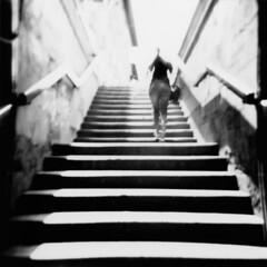 Going (blank) again (ale2000) Tags: people blackandwhite bw white black scale stairs mediumformat underground square florence blackwhite holga stair gente steps perspective railway bn stairway persone photowalk scala firenze handrail passage stazione bianco nero biancoenero prospettiva scalinata ilfordfp4 gradini corrimano aledigangicom