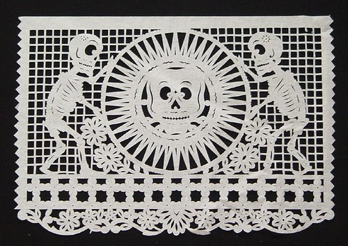 Aztec Sun Stone and Skeletons