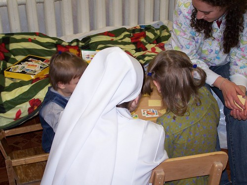 4 and 5 year old orphan girls with a nun