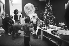 Navarik kids' Christmas 4 (Derek K. Miller) Tags: santa christmas xmas blackandwhite bw tree film vancouver kodak christmastree christmasparty santaclaus xmastree xmasparty bw400cn navarik