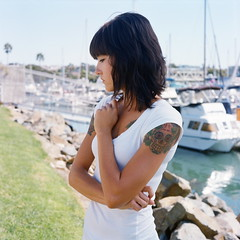 Larissa Waits for Her Ship to Come In (Lou O' Bedlam) Tags: portrait tattoo kodakportra400vc pacificocean oceanside larissa mamiyac330 80mm louobedlam lounoble 101208