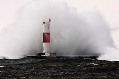 Arctic Blast (James Marvin Phelps) Tags: winter lighthouse outdoors photography michigan great lakes lakemichigan jmp crashingwaves ludingtonmichigan mandj98 jamesmarvinphelps ludingtonsouthbreakwaterlight
