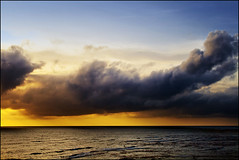 The Golden Light. (Sal Virji (Sal's Marine) on / off) Tags: ocean blue sunset sea sky orange sun india seascape beach nature water rain yellow clouds sunrise canon landscape waterfront dramatic bluesky minimal monsoon arabian seafront bandstand filters drama minimalist sal coluds cloudscapes bandra virji arabiansea famouslandmark sunsetlandscape 400d canon400d indiasunset seascapeindia salsmarine canon24mmto105mmlisusm 24mmto105mmlisusm salvirji indiaseascape bandraseafront goldentsky
