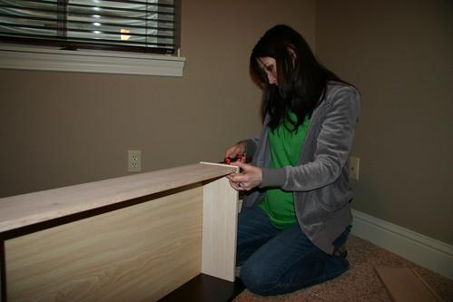 Jessa putting together Jack's dresser
