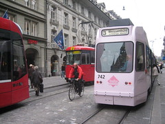 pink tram! (godoftosh) Tags: city travel pink public stone modern switzerland europe cyclist swiss transport bern trams tramway weissenbuhl