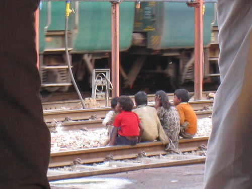 Small kids hanging out on the train tracks