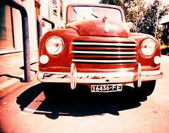 Baby you can drive my car (Ilaria ♠) Tags: car vintage xpro crossprocess toycamera ferrara oldcar macchina fujisensia vivitarultrawideslim toycamerafotografiaanalogicaitalia fujisensiaii100ra sviluppoinvertito dominanterossachesispreca