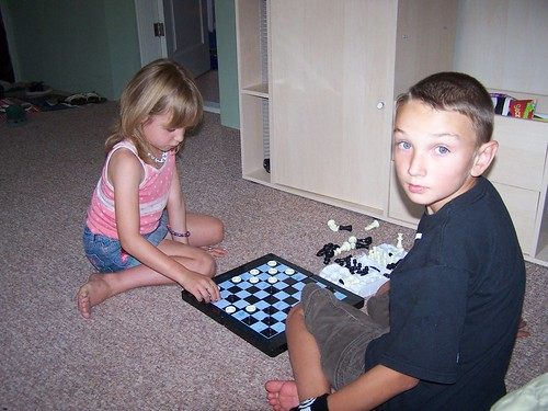 Josie and Maxime playing checkers