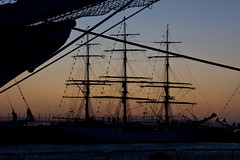 Tall Ships at the Wellington Dock (John_Kennan) Tags: sunset sea water silhouette night liverpool canon river dark eos evening boat dock sailing ship glow rope nighttime maritime sail mast nautical dslr 2008 tallships height mersey rigging afterdark capitalofculture rivermersey wellingtondock