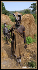 Mursi Tribe Girl Lip Plate, Mago National Park, Lower Omo Valley, Ethiopia (Peter Akkermans) Tags: poverty africa travel vacation portrait people holiday digital maastricht person photography photo foto fotografie photographer minolta character traditional poor picture culture social tribal adventure peter journey valley omovalley ethiopia tribe society mursi cultural thirdworld konicaminolta imagesgooglecom fotograaf googlecom yahoocom dynax5d loweromovalley mursitribe akkermans reisfotografie magonationalpark reisfoto peterakkermans fotoakkermans fotoakkermansnl wwwfotoakkermansnl