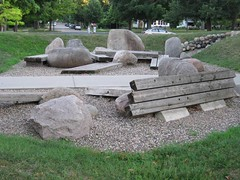 "<p>Title: ""Sticks and Stones""<br/>Sculptor: Raymond I. Jacobson and Carleton students<br/><br/>Accessible to Public: yes, outside<br/>Location: center of campus<br/>Ownership: Carleton College<br/>Medium: Boulders, erth berm and timbers<br/>Dimension: 50 feet by 24 feet<br/>Provenance: college funds<br/>Year of Installation: <br/>Physical Condition: requires maintenance</p>"