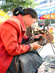 Keen Sandals get new rubber on sole in Huini, Gansu Province, China
