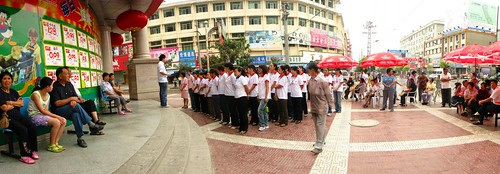 Morning outdoor briefing for supermarket staff in Shangnan, Shaanxi Province, China