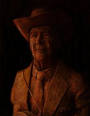Bill Monroe Statue (eighthave) Tags: old sculpture orange brown man smile face statue blackbackground lowlight nashville guitar tennessee coat tie opry craggy cowboyhat countrymusic opryland grandoleopry kerchief billmonroe blueg